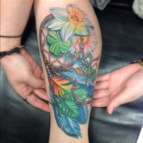 dream catcher tattoo with flowers dreamcatcher with 4 leaf clover and flowers by daniel