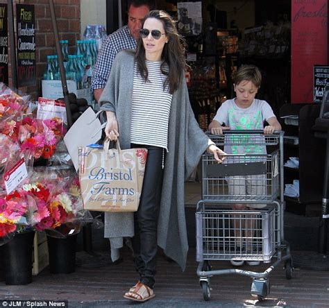 angelina jolie brings son knox to military supply store angelina jolie and son knox pick up groceries together in