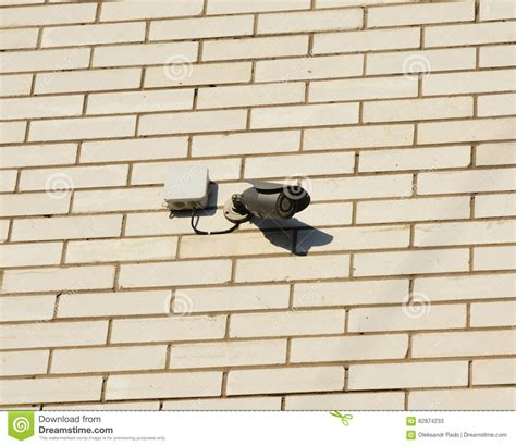 security mounted on brick wall stock photo
