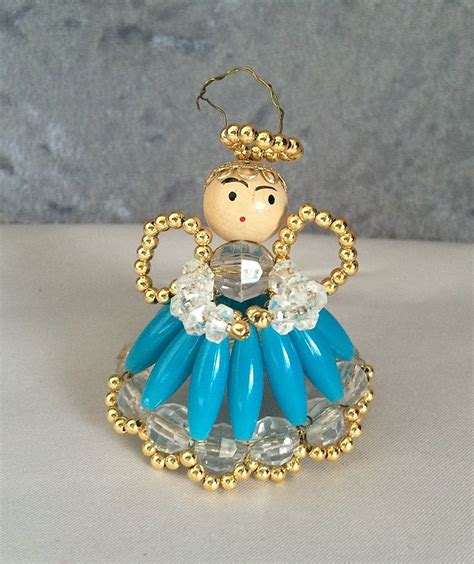 Dress Ornaments - 1960s vintage in a blue dress beaded