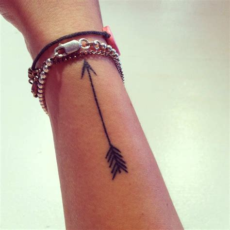 side of wrist tattoo follow your arrow by musgraves brown eyed twenty