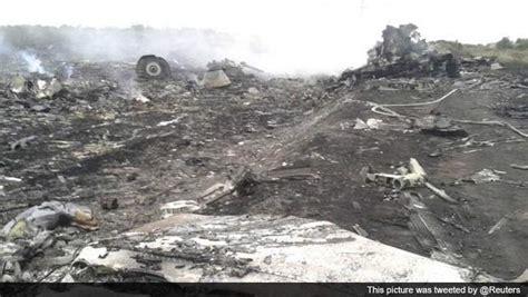 malaysia airlines flight 17 shot down in ukraine how did burning wreckage dozens of bodies at scene of plane crash