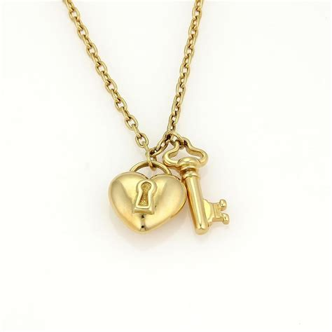 co 18k yellow gold puff lock key pendant