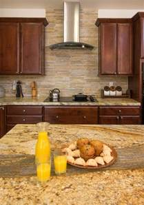 yellow river granite and backsplash idea decor