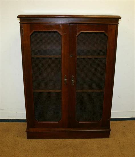 antique style traditional walnut enclosed mesh doors