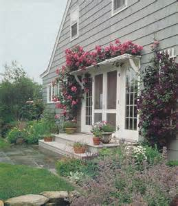 pergola with roses over french door house exterior pinterest