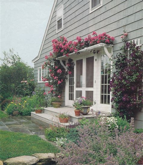 Pergola With Roses Over French Door House Exterior Pergola Front Door