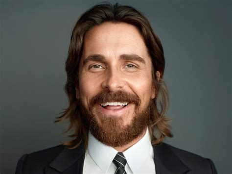 hollywood male celebrity with round face actor christian bale long hairs smile beard face