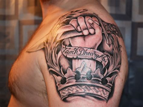 badass shoulder tattoos dagger in and crown on left shoulder for