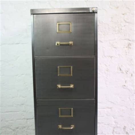 mid century polished steel filing cabinet with brass