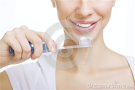 closeup with toothbrush cleaning teeth at home