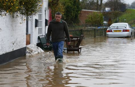 uk weather flood warnings stay but heavy rain expected to