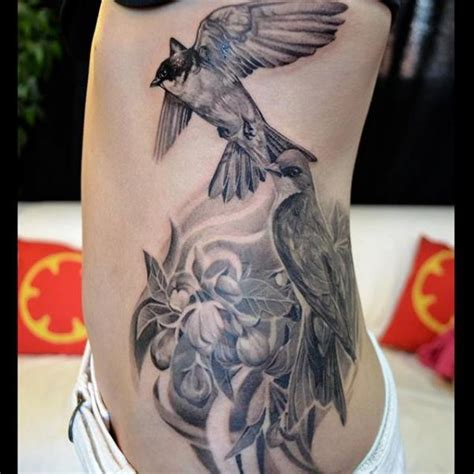 realistic side bird tattoo by elvin tattoo