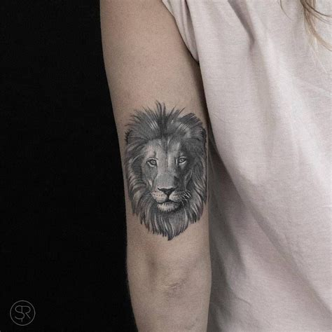 small lion head tattoo on the back of the left arm tattoos