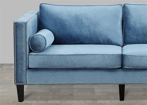 blue velvet sofa with nailheads