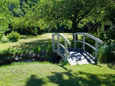 garden footbridge beautiful small white wooden bridge footbridge in a garden