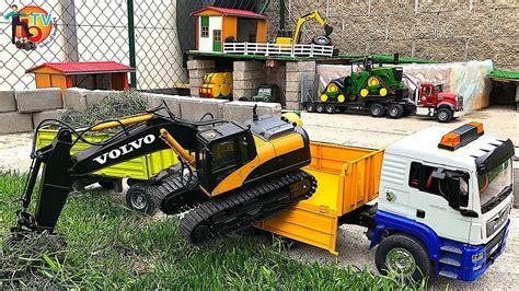 bruder rc excavator volvo rc truck man  trailer fliegl youtube