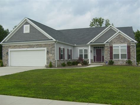 house with gray siding shutters on a stone house siding dk gray shakes white trim wineberry shutters