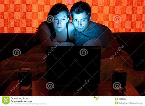 couch free movies couple on a couch watching a movie royalty free stock