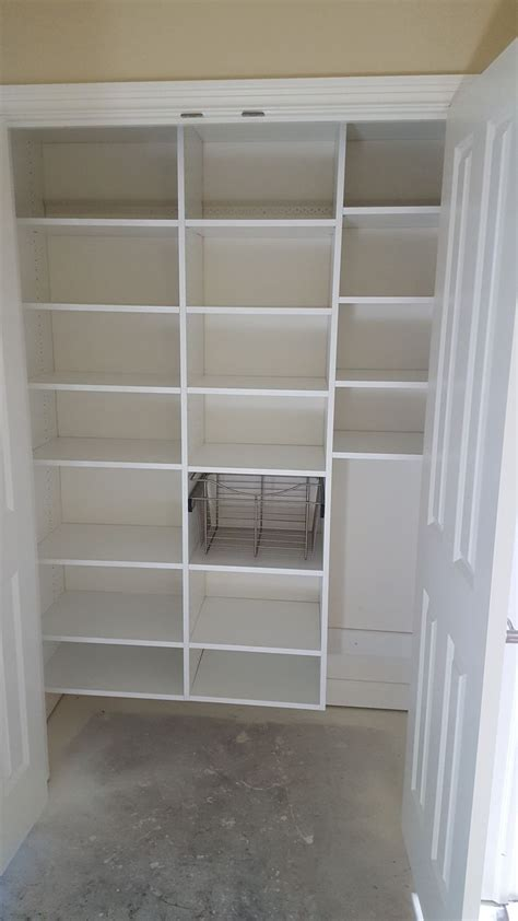 white melamine pantry  adjustable shelves  pull