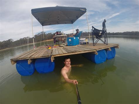 diy portable pontoon using old pallets and old blue drums - Portable Pontoon