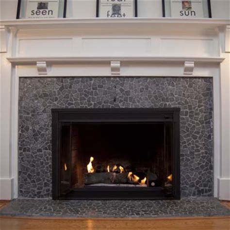 covering brick fireplace with ceramic tile pebble tile is the perfect way to cover ugly old tiles