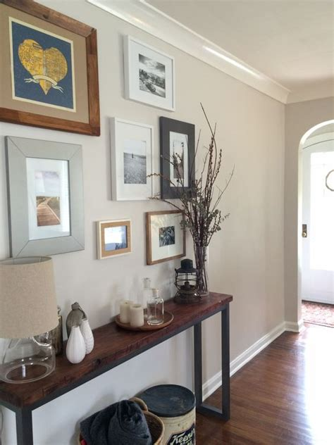 benjamin moore pale oak fin a hallway with medium toned wood floors and a small art gallery