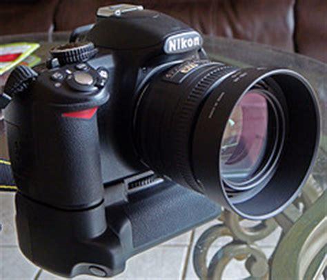 Grip Kamera Nikon D3100 nikon d3100 with 18 105mm 50 mm f 1 8 g and battery grip