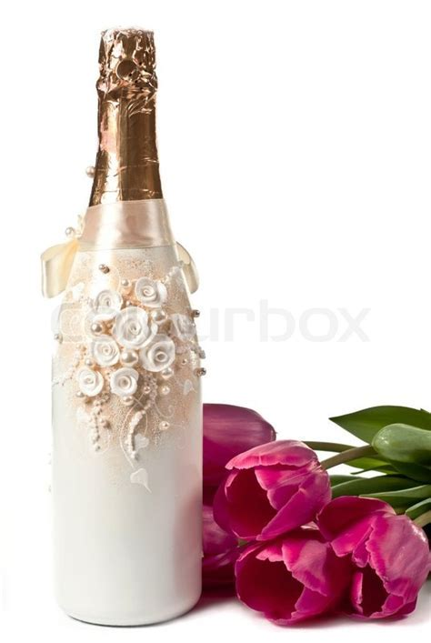 Beautiful bottle of champagne with tulips isolated on