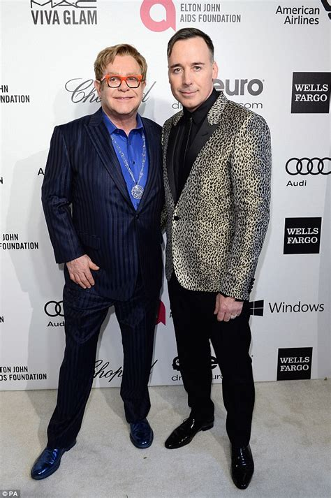 elton john and husband elton john defends david furnish amid accusations his