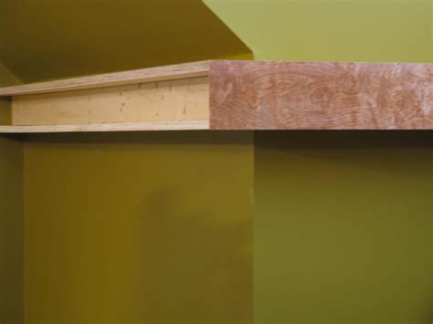 build floating shelves to wrap around a corner wall hgtv
