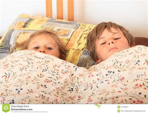 girl lying bed with flowers kids going to sleep stock photo image 41136610
