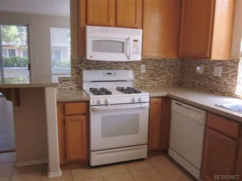 backsplash ideas for light oak cabinets tile backsplash in builder grade kitchen light oak