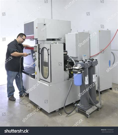 cnc machine operator on a wire edm stock photo 150560267