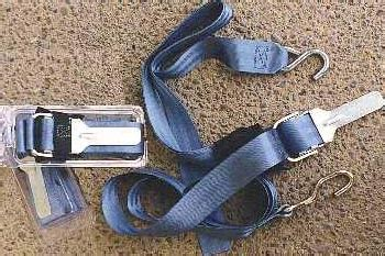 bow of boat bouncing on trailer boat tie down strap
