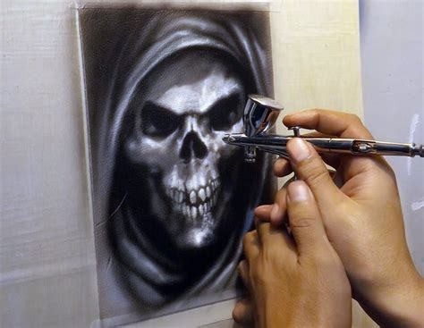 with airbrush airbrushing skull on leather