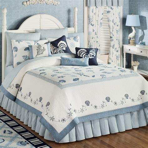 blue tosca bedding set with shell pattern placed on the white bedding sheet with shells pattern combined with