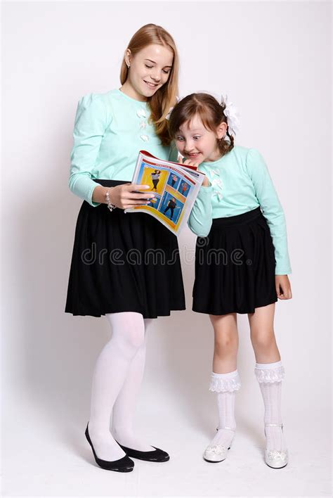 school girl uniform stock photos pictures royalty free young schoolgirls stock photo image 74384870
