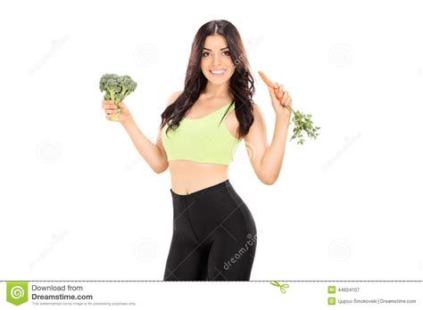 Pear Shape Detoxes by Slim Holding A Carrot And A Broccoli Stock Photo