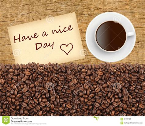 Cup Of Coffee, Grains And Have A Nice Day Massage On Wooden Stock Photo   Image: 61835128
