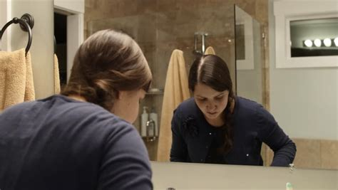 woman going to bathroom a couple brushes their teeth before going to bed at night stock footage video 8942584