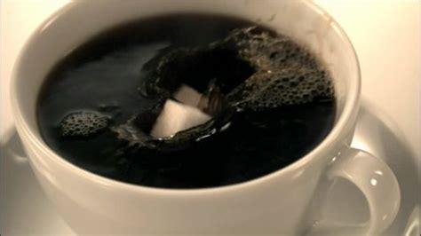 Americano No Sugar Coffee In A Bottle coffee sugar cube dunking hd stock 733 450 029 framepool stock footage