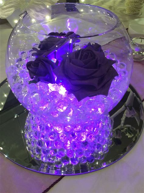 fish bowl wedding centrepiece for purple themed weddings