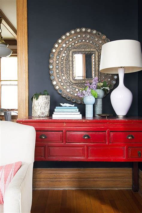 red console peacock mirror black walls making