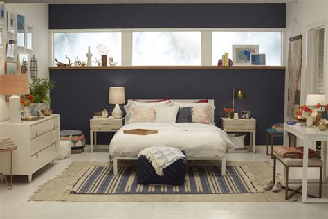 navy blue accent wall bedroom ideas featuring simple white iron bed frame and ethnic