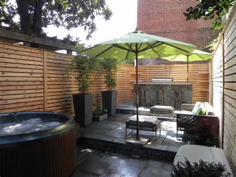 outdoor kitchen  privacy fence  stone patio