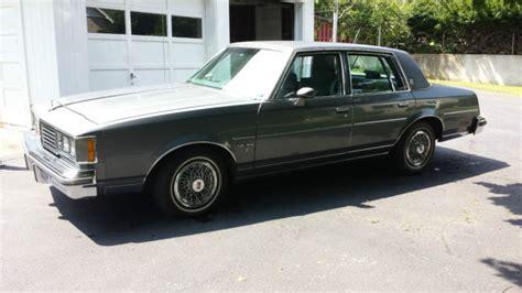 oldsmobile cutlass supreme brougham sedan  door