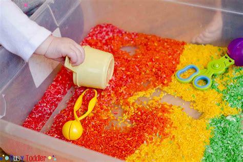 Rainbow Rice Orange rainbow rice sensory bin busy toddler