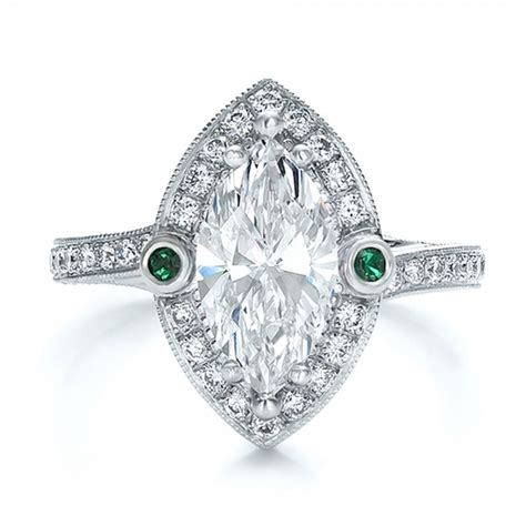 custom marquise with halo and emerald engagement ring