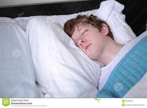 man sleeping in bed young man sleeping in bed close up stock images image